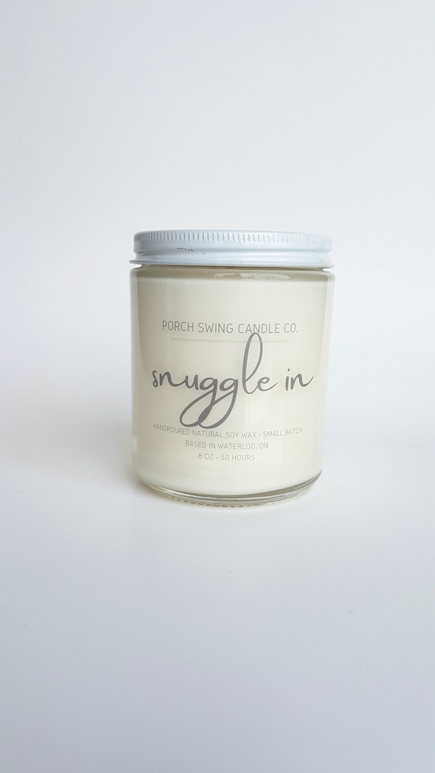 hand-poured soy wax candle in 8 oz. jar with lid
